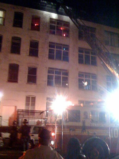 Firefighters on the scene to rescue a man who fell 60 feet into a building shaft at 141 S 5th Street