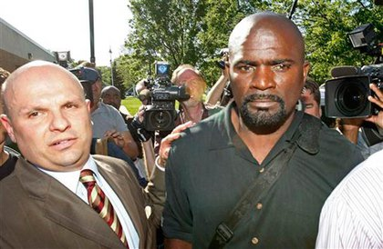 Lawrence Taylor, with defense lawyer Arthur Aidala