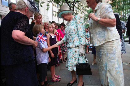 The Queen greets a young fan