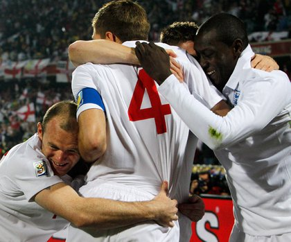 Steven Gerrard (#4) celebrates with his teammates after scoring for England.