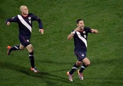 Clint Dempsey, right, celebrates his equalizing goal.