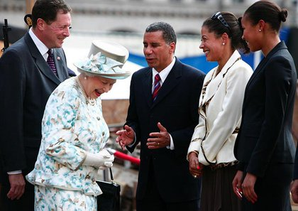 Governor Paterson, with wife Michelle Paige-Paterson and their daughter Ashley Dennis, regales the Queens