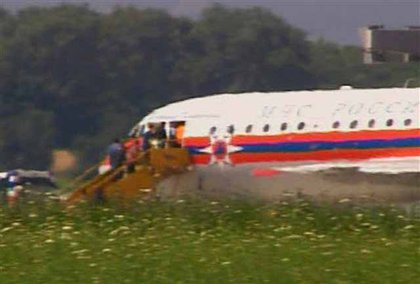 Image of unidentified people ascending stairs of a Russian plane in Vienna