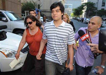 Son of accused spies Juan Lazaro and Vicky Peleaz, Juan Jose Lazaro, center, and Peleaz's sister, Raquel Pelaez Ocampo, left.