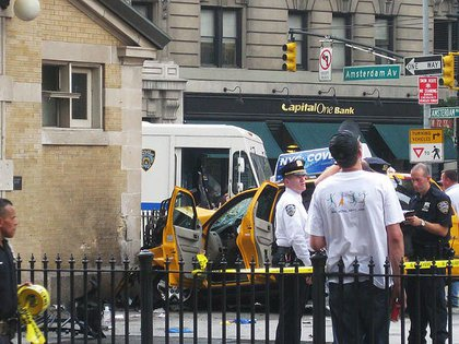 Because what you want to see when you're heading to the subway station is a taxi crashed into the head house.