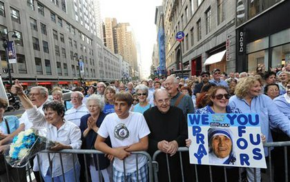 Protesters who  think the Empire State Building should have been lit in honor of her