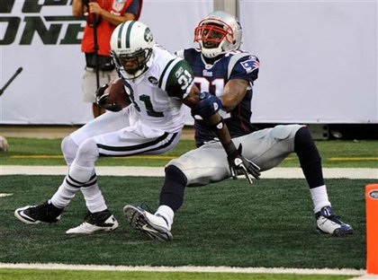 Antonio Cromartie getting tackled after making an interception