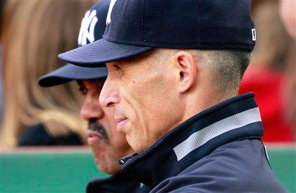 Joe Girardi looks on as the Yankees lost to Boston