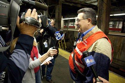 MTA Deputy Director of Safety Joseph Streany talks to reporters