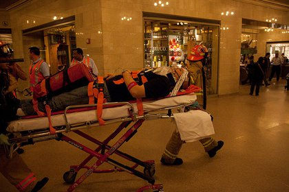 """Taking a volunteer """"victim"""" through Grand Central for treatment"""