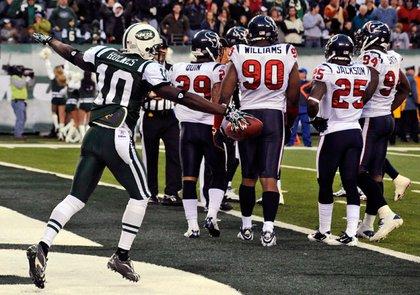 Santonio Holmes celebrates yet another game-winning touchdown.