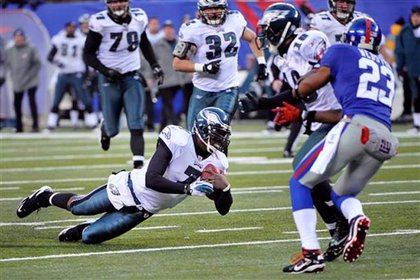 Michael Vick dives for extra yards in the 4th quarter at the Meadowlands