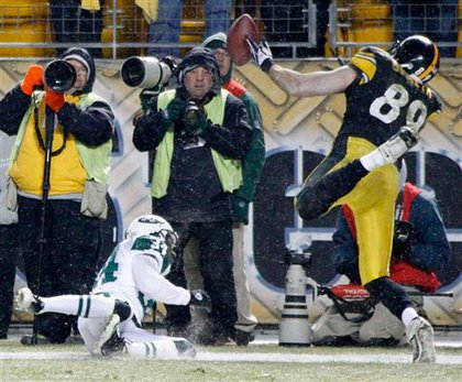 The Jets' Marquice Cole breaks up a pass during the final play of the Jets-Steelers game