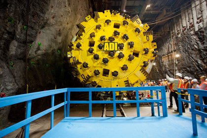 The face of the boring machine- notice the wheels that help it rotate and the giant teeth for cutting rock.