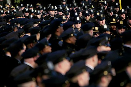 Police from across the nation line up for the funeral of slain NYPD Officer Peter Figoski