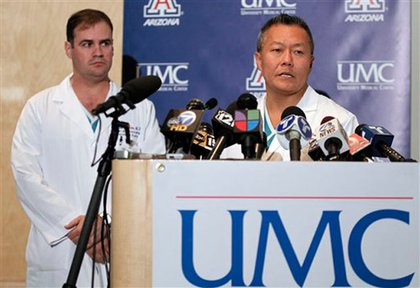 Dr. Michael Lemole, left, chief of neurosurgery, and Dr. Peter Rhee, trauma director, discuss Rep. Giffords' condition.