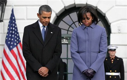 President Obama and the First Lady observe a moment of silence.