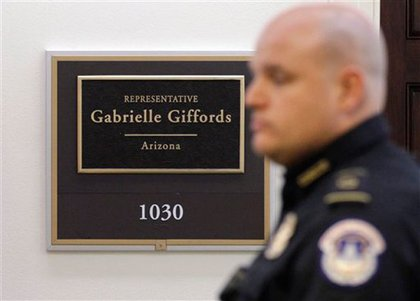 A Capitol police officer outside Rep. Giffords' office.