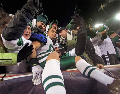 Jets players celebrate with fans