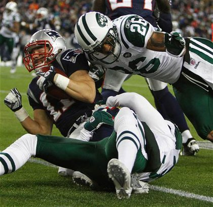 Patriots wide receiver Julian Edelman is brought down by New York Jets cornerback Dwight Lowery