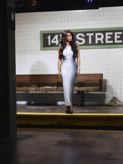 A publicity still for Kourtney & Kim Take NY—she has been on the subway