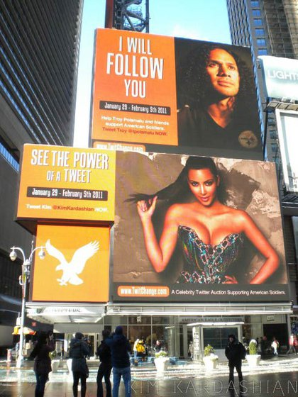 """Another Tweeted photo, this time of her billboard in Times Square—not bad for a girl who broke out after the """"leak"""" of her sex tape with Ray J"""
