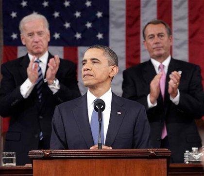President Barack Obama, with Vice President Joe Biden and House Speaker John Boehner behind him