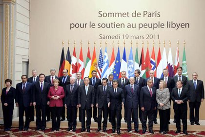 European, Arab and U.S. leaders gather for a photo: From left, foreground, German Chancellor Angela Merkel, European Union president Herman Van Rompuy, UN Secretary General Ban Ki-moon, France's Prime minister Francois Fillon, President Nicolas Sarkozy, Foreign minister Alain Juppe, Arab League chief Amr Mussa. Background : Canadian Prime minister Stehphen Harper, Iraqi's Foreign minister Hoshyar Zebari, UAE foreign minister Sheikh Abdullah bin Zayed bin Sultan Al Nahyan, Italian Prime minister Silvio Berlusconi, Poland's Prime Minister Donald Tusk, Spanish Prime Minister Jose Luis Rodriguez Zapatero, Greek Prime Minister George Papandreou, Dutch Prime minister Mark Rutte