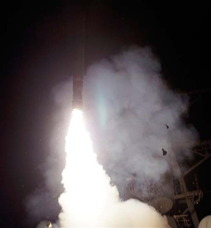 A Saturday, March 19, 2011 photo provided by the U.S. Navy shows the Arleigh Burke-class guided-missile destroyer USS Barry (DDG 52) as it launches a Tomahawk missile in support of Operation Odyssey Dawn from the Mediterranean Sea