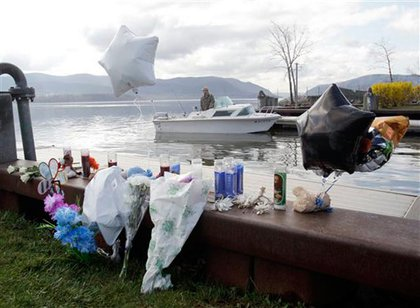 Flowers, bears, candles and balloons left in memory of Armstrong and the children