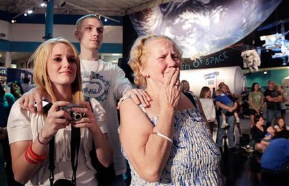 Houston resident Diane Breener cries after learning her city won't get a space shuttle