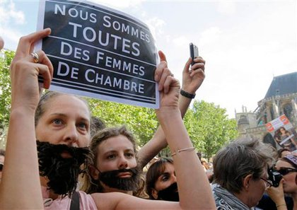French women protest the political and media reaction to Dominique Strauss-Kahn's arrest, namely comments made by others that suggest rape of servants might be okay.