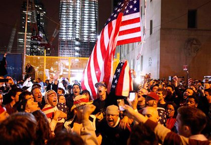 Crowds gather at Ground Zero after hearing that Osama bin Laden has been killed