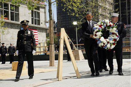 President Obama carries a wreath at Ground Zero; with him is Firefighter Joe LaPointe