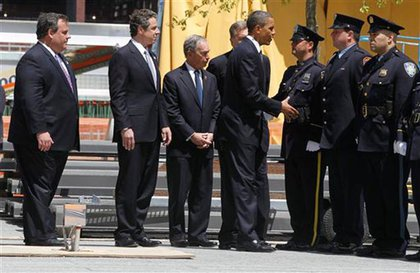 President Obama, with Mayor Bloomberg and Governors Cuomo and Christie, greets officers