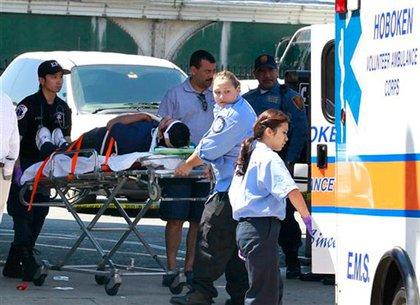 An injured passenger is taken away
