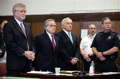 In court with his high-powered legal team.