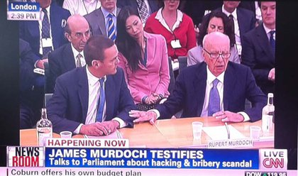 Check out former NYC Schools Chancellor Joel Klein and Murdoch's wife Wendi in the row behind him!