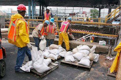 New York City Transit employees built a sea wall at Lenox Yard in Harlem to prevent water from flowing into the yard.