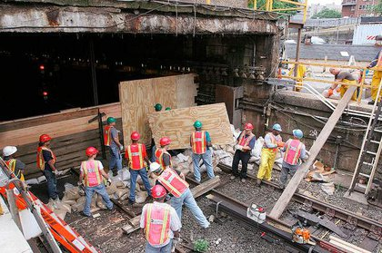 New York City Transit employees built a sea wall at Lenox Yard in Harlem to prevent water from flowing into the yard yesterday