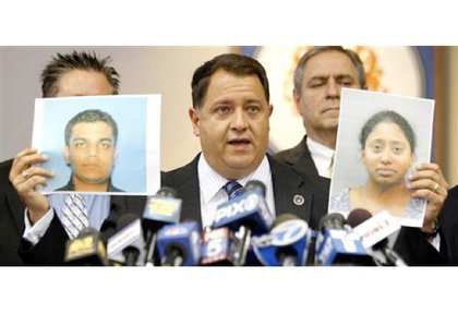 Morris County Prosecutor Robert Bianchi holds the police booking photos of Kashif Parvaiz, left, and Antoinette Stephen