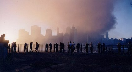 People looking at the smoking site from Brooklyn Heights