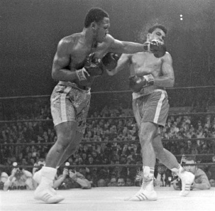 "Frazier uses his left hook on Ali in ""The Fight of the Century"""