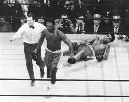Joe Frazier is directed to a corner by referee Arthur Marcante after Frazier knocked down Muhammad Ali during the 15th round of the title bout in Madison Square Garden in New York