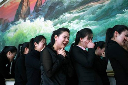 The Chinese news agency released this photograph of weeping North Koreans in China