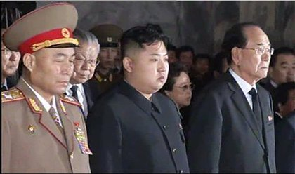Kim Jong-un, center, pays his respects