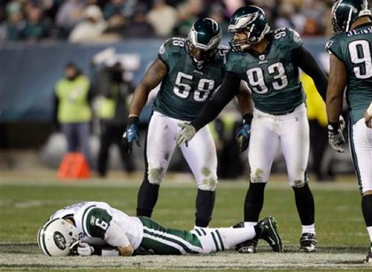 The Jets' Mark Sanchez remains on the field after being sacked in Philadelphia.