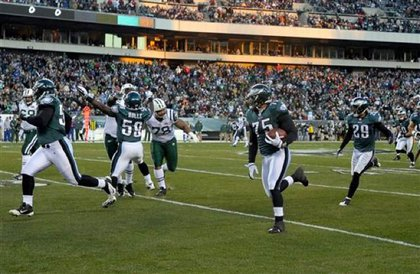 Philadelphia Eagles defensive end Juqua Parker (75) runs with a recovered fumble for a touchdown in the first half of the Eagles victory over the Jets.
