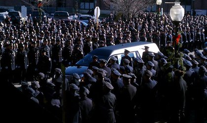 Police officers line the streets to pay respects to slain NYPD Officer Peter Figoski