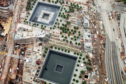 Looking down at the 9/11 Memorial from the top of 1 WTC